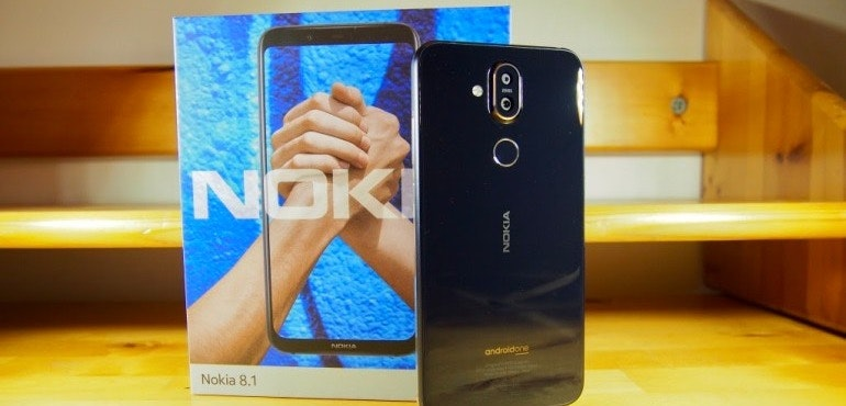 Nokia 8.1 next to box hero size