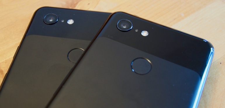 Google Pixel 3 and 3XL backs black in hand close up lens hero size