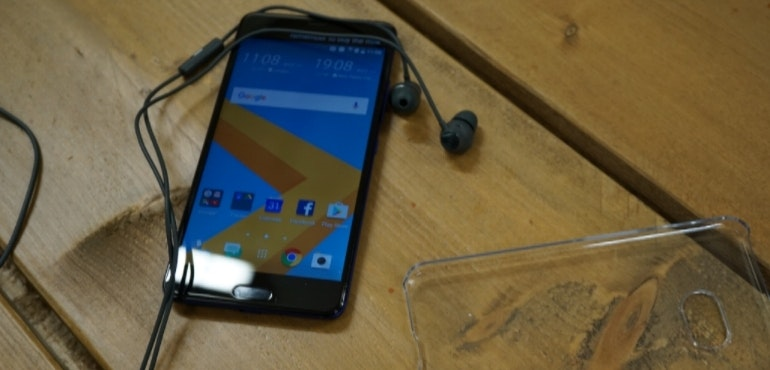 HTC Ultra with clear case and earphones