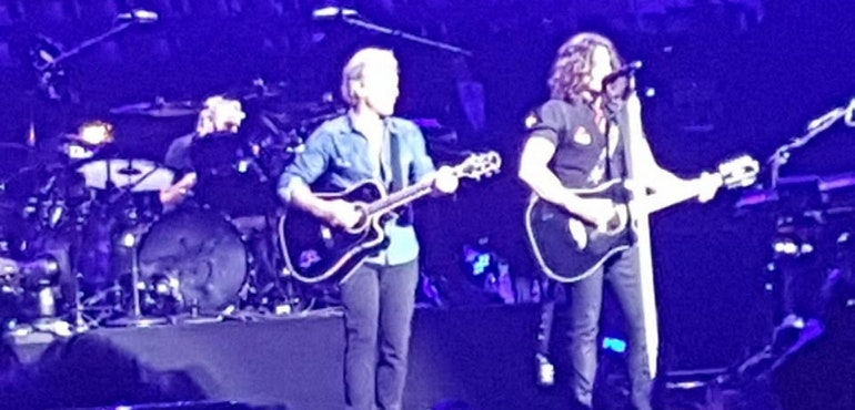 Bon Jovi in poor lighting conditions but still looking awesome