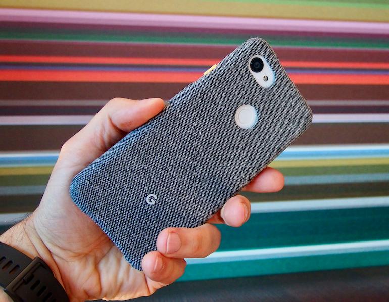 Google Pixel 3a in hand case on landscape