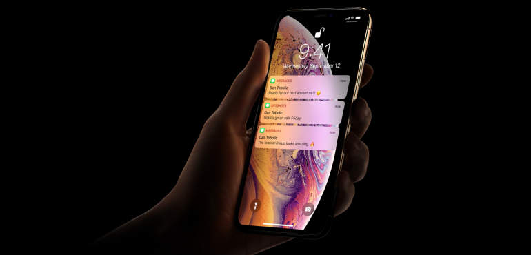 iPhone Xs in hand notifications unlock hero size