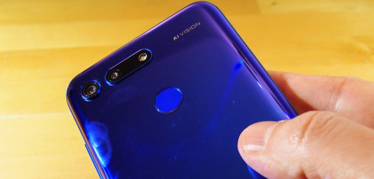 Honor View 20 back in hand fingerprint scanner closeup hero size