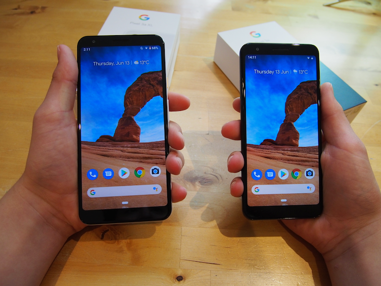 Google Pixel 3a and 3XL side to side in hand