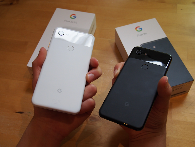 Google Pixel 3a and 3XL side to side in hand back