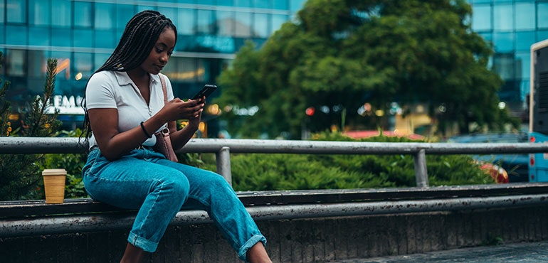 woman using her 5G smartphone in a city