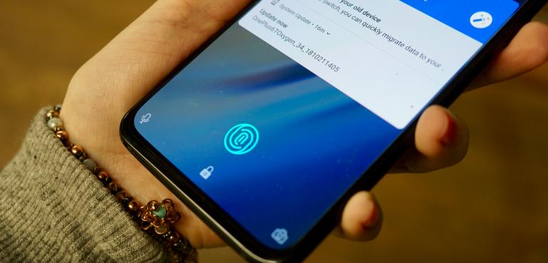 OnePlus 6T in screen fingerprint scanner before hero size