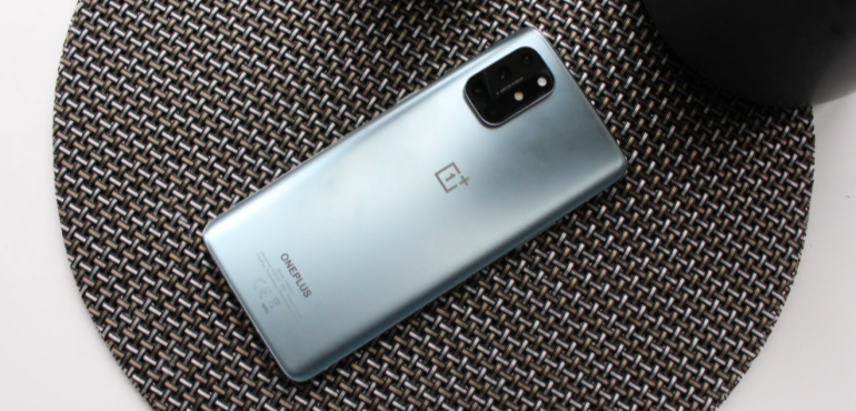 OnePlus 8T silver back on table hero